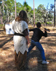 A young visitor learns the Atlatl